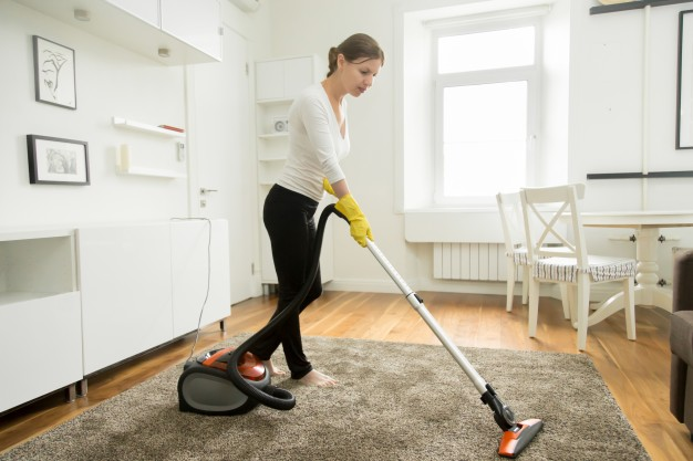 woman-casual-wear-vacuum-cleaning-carpet